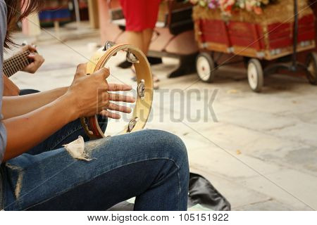 A Man Is Playing Tambourine At The Park