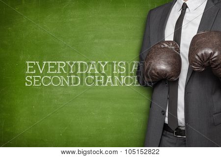 Everyday is a second change on blackboard with businessman on side