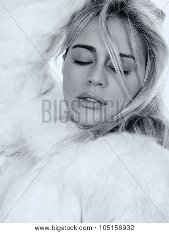Beautiful Glamour girl isolated with a fur coat