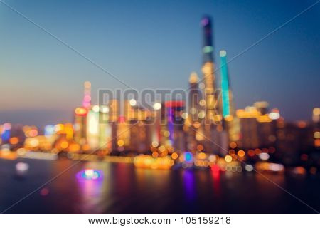 Panorama view of Shanghai city at night time. Bokeh blur.