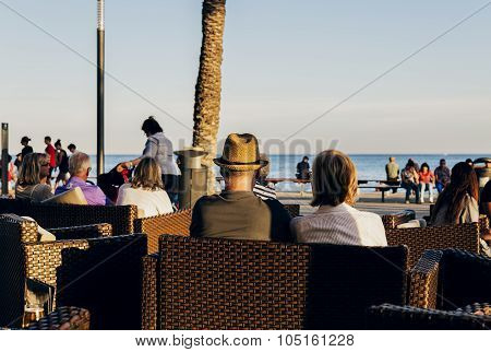 People sat in a terrace of torrevieja,spain  with a view to the sea