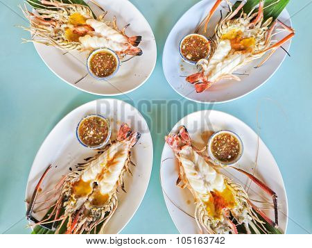 Grilled Shrimp on a plate at the table