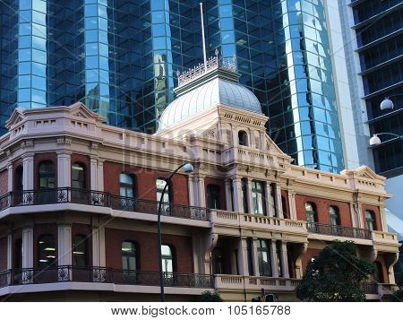 Old classical building in front of skyscrapers in Perth.