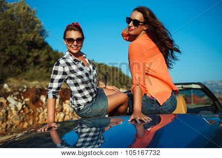 Two Young Girls Having Fun In The Cabriolet Outdoors