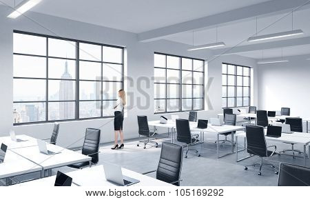 A Lady In Formal Clothes Is Looking Out The Window In A Modern Panoramic Office In New York. Corpora