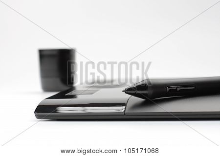 A Close-up Of  Pen On Graphic Tablet On White Background