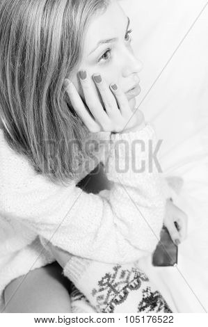 Beautiful blond young woman in knitted sweater