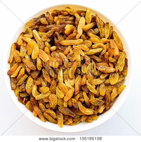 Fine golden variety raisins kept in a bowl on a white background