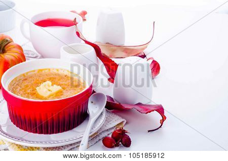 pumpkin porridge of rice on a white background