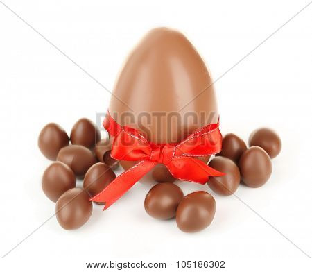 One big and small chocolate Easter eggs isolated on white
