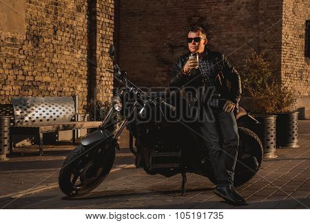 Man With A Cafe-racer Motorcycle Outdoors