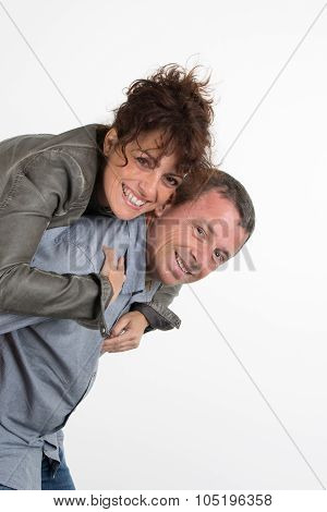 Handsome Man Giving Piggy Back To His Girlfriend On White Background