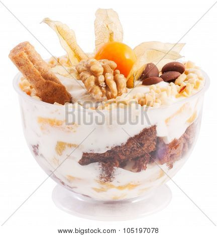Dessert In A Transparent Cup Of Cream, Peaches, Nuts