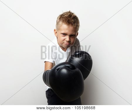 Little boxer fighter standing in boxing gloves and he ready to fight