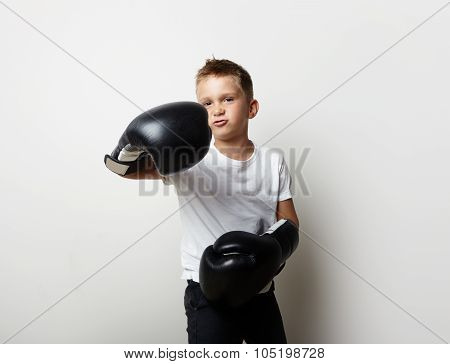 Little fighter standing in boxing gloves and shows his jab