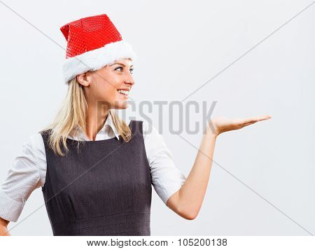 Business woman with Santa Hat holding your product