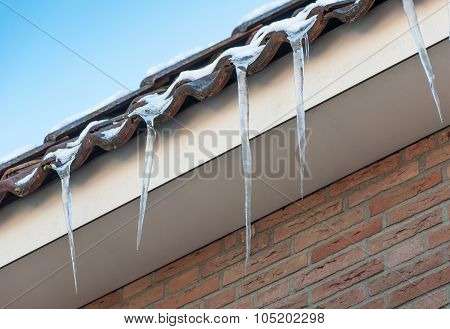 Dangling Icicles On The Eaves