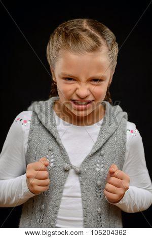 Little girl standing on black background