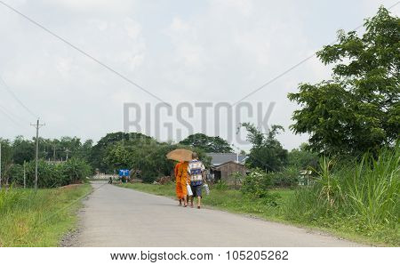 Asian Young Monks Walking Morning Alms
