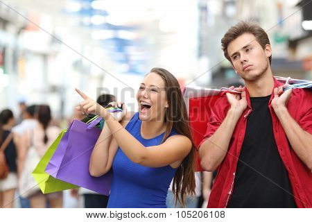 Man Bored Shopping With His Girlfriend