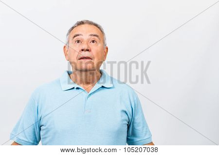 Surprised senior man thinking