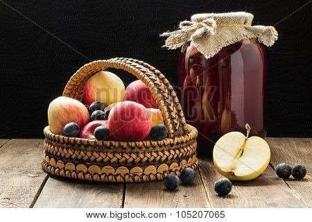 Apples And Blackthorn In A Basket And Canned Fruit Compote Of A Bank