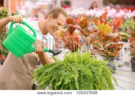 Professional florist holding water pot