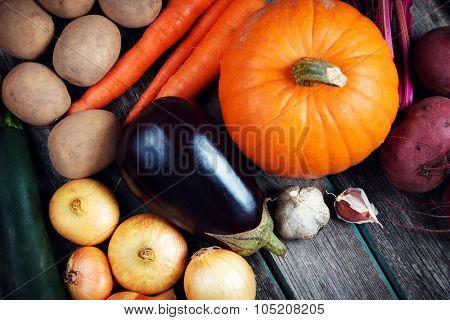 Vegetables on old wooden background