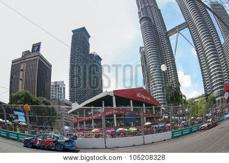 KUALA LUMPUR, MALAYSIA - AUGUST 09, 2015: Chaz Mostert from the Pepsi Max Crew team races in the V8 Supercars Street Challenge at the 2015 Kuala Lumpur City Grand Prix.