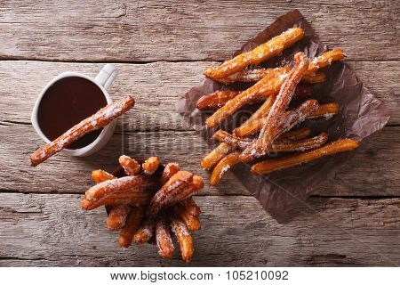 Churros And Hot Chocolate On The Table. Horizontal Top View
