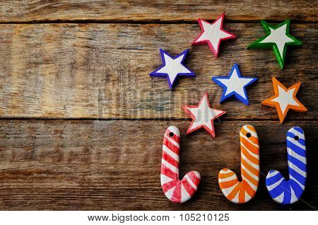 Wooden Background With Wooden Toys In The Shapes Of Stars And Christmas Shaped Sticks For Christmas
