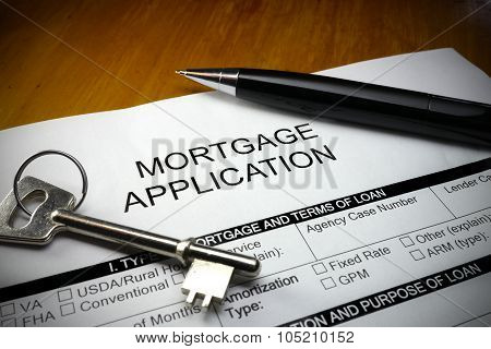 Mortgage application form with pen and key