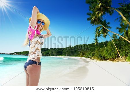 Girl on the beach at sunny day