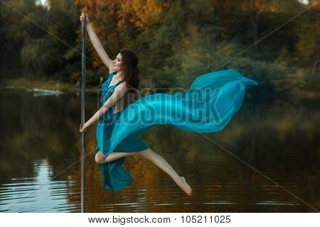 Girl Flying Dance, And Her Dress Developing The Wind.