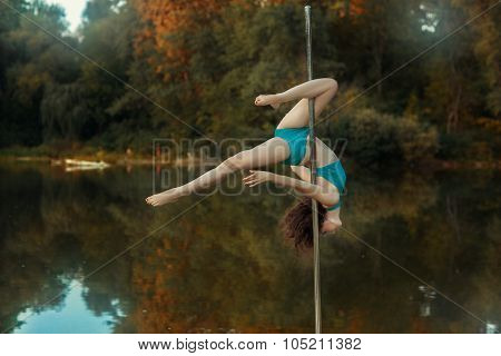 Girl Revolves On The Pole For Dancing Performing Tricks.