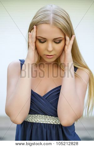 Young blonde woman suffering of the pain, indoor