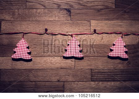 cute new year red and white checkered christmas tree decoration on parquet