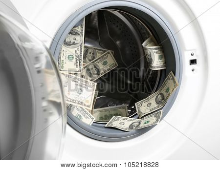 Dirty money in washing machine, close up
