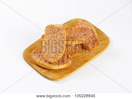 cinnamon rusks on wooden cutting board