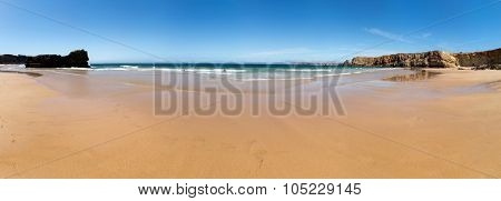 Beautiful summer seashore with rocky hills, Portugal