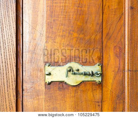 Close up of wooden cupboard with a hook lock