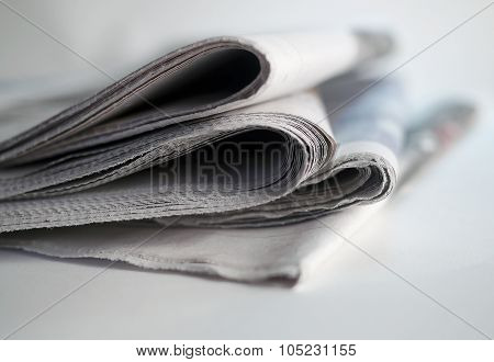 stack of newspapers on white background