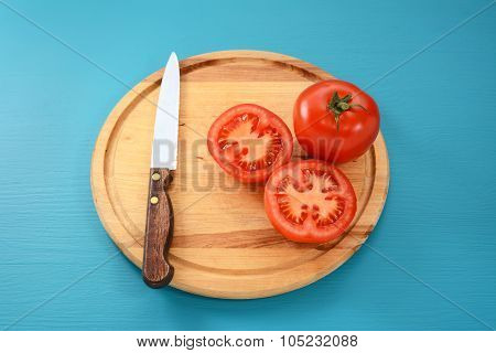Whole And Halved Tomato With Kitchen Knife