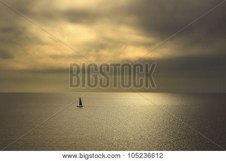Ocean Sea Sunset View And Black Sail Boat. Mediterranean Sea. Italy