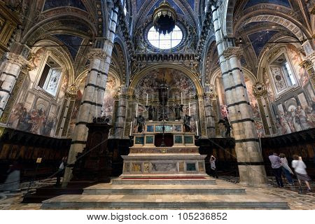 SIENA, ITALY - October 10, 2015: Interior of Siena Cathedral, Italian Duomo di Siena, Santa Maria Assunta. The 13th century church with its mosaic floor is a major tourism attraction in Siena, Italy