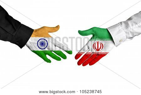India and Iran leaders shaking hands on a deal agreement