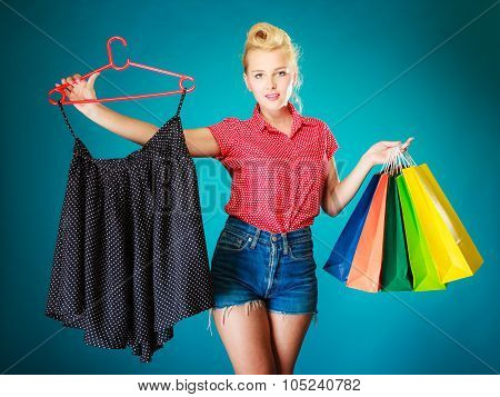 Pinup Girl With Shopping Bags Buying Skirt. Sale