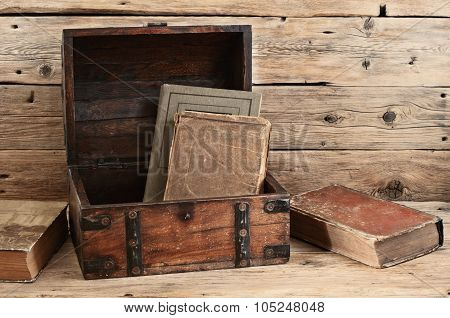 Old Books In Vintage Chest Closeup