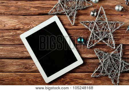 Tablet With Blank Screen On Wooden Background