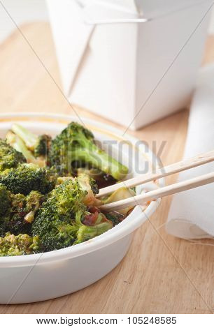 close up of chinese takeout consisting of broccoli in garlic sauce